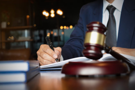 Close up lawyer businessman working or reading lawbook in office workplace for consultant lawyer
