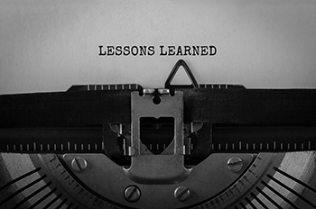 """""""Lessons learned"""" written on a typewriter"""