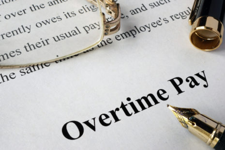 Overtime pay concept written on a paper.