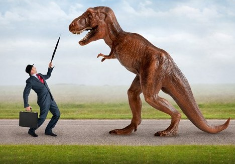 Business man and t-rex face off