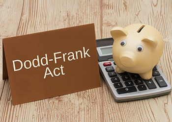 Dodd Frank Act and Piggy Bank on Calculator