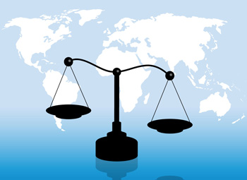 Scales of justice on top of a world map