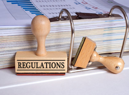 Regulations - rubber stamp with binder in the office